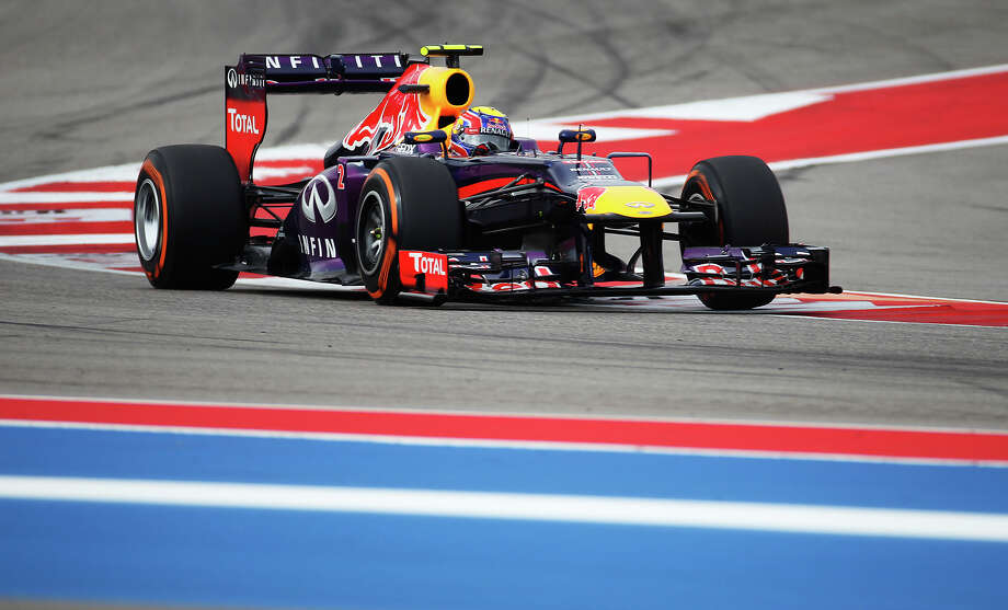 Infiniti Red Bull Racing driver Mark Webber rounds a corner at the Formula One United States Grand Prix morning practice session at the Circuit of the Americas near Austin, Texas on Saturday, Nov. 16, 2013. Photo: Kin Man Hui, San Antonio Express-News / ©2013 San Antonio Express-News