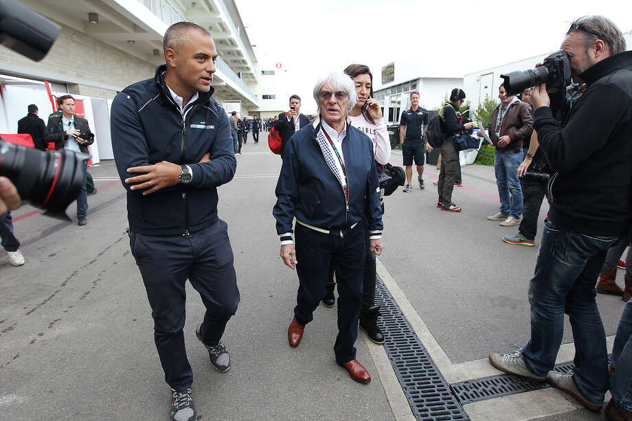 President and CEO of Formula 1 Bernie Ecclestone (center) strolls the paddock area at the Circuit of the Americas near Austin, Texas on Thursday, Nov. 14, 2013. Photo: Kin Man Hui, San Antonio Express-News / ©2013 San Antonio Express-News