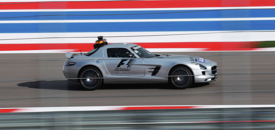 A Formula 1 safety car drives the course for track familiarization and system checks at the Circuit of the Americas near Austin, Texas on Thursday, Nov. 14, 2013. Photo: Kin Man Hui, San Antonio Express-News / ©2013 San Antonio Express-News