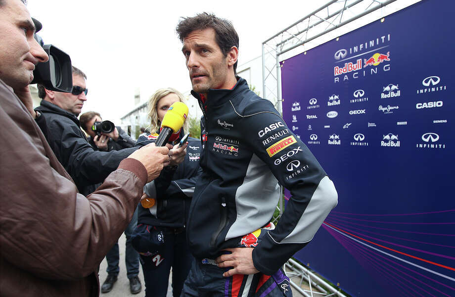 Red Bull Racing driver Mark Webber talks with media at the Circuit of the Americas near Austin, Texas on Thursday, Nov. 14, 2013. Photo: Kin Man Hui, San Antonio Express-News / ©2013 San Antonio Express-News