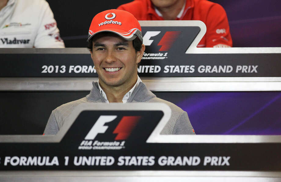 McLaren driver Sergio Perez answers questions during a press conference at the Circuit of the Americas near Austin, Texas on Thursday, Nov. 14, 2013. Photo: Kin Man Hui, San Antonio Express-News / ©2013 San Antonio Express-News