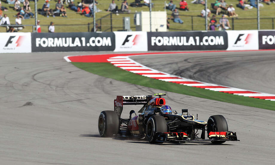 Lotus F1's Romain Grosjean runs off track on Turn 20 at the Formula One United States Grand Prix afternoon practice session at the Circuit of the Americas near Austin, Texas on Friday, Nov. 15, 2013. Photo: Kin Man Hui, San Antonio Express-News / ©2013 San Antonio Express-News