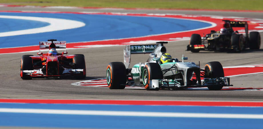 Mercedes AMG Petronas' Nico Rosberg leads a group of drivers during the Formula One United States Grand Prix morning practice session at the Circuit of the Americas near Austin, Texas on Friday, Nov. 15, 2013. Photo: Kin Man Hui, San Antonio Express-News / ©2013 San Antonio Express-News
