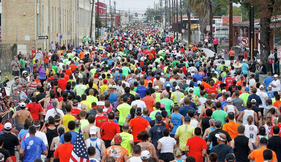 Runners head north on Cherry Street  at the start of the Rock 'n' Roll San Antonio Marathon and 1/2 Marathon on Sunday, Nov. 17, 2013. Photo: MARVIN PFEIFFER, Marvin Pfeiffer/ Express-News / Express-News 2013
