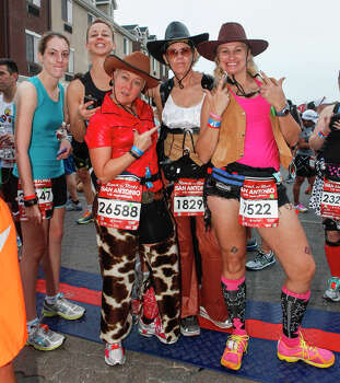 Kristen Pearless (from left), Sarah Tofanelli, Becky Kellhofer, Callie Ullman and Linda Bachard at the starting line prior to the the Rock 'n' Roll San Antonio Marathon and 1/2 Marathon on Sunday, Nov. 17, 2013. Photo: Marvin Pfeiffer, San Antonio Express-News / Express-News 2013
