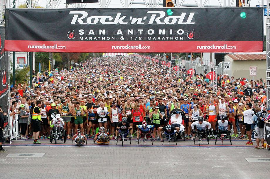 The wheelchair contestants take off at the start of the Rock 'n' Roll San Antonio Marathon and 1/2 Marathon on Sunday, Nov. 17, 2013.  Photo: Marvin Pfeiffer, San Antonio Express-News / Express-News 2013