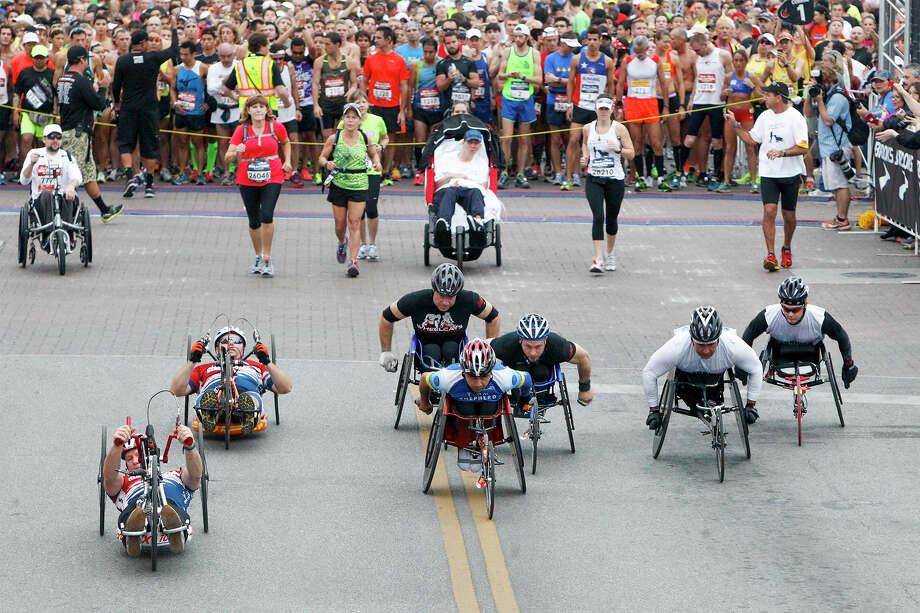 The wheelchair contestants take off at the start of the Rock 'n' Roll San Antonio Marathon and 1/2 Marathon on Sunday, Nov. 17, 2013. Photo: MARVIN PFEIFFER, Marvin Pfeiffer/ Express-News / Express-News 2013