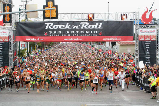 Runners leave the starting line of the Rock 'n' Roll San Antonio Marathon and 1/2 Marathon on Sunday, Nov. 17, 2013. Photo: Marvin Pfeiffer, San Antonio Express-News / Express-News 2013