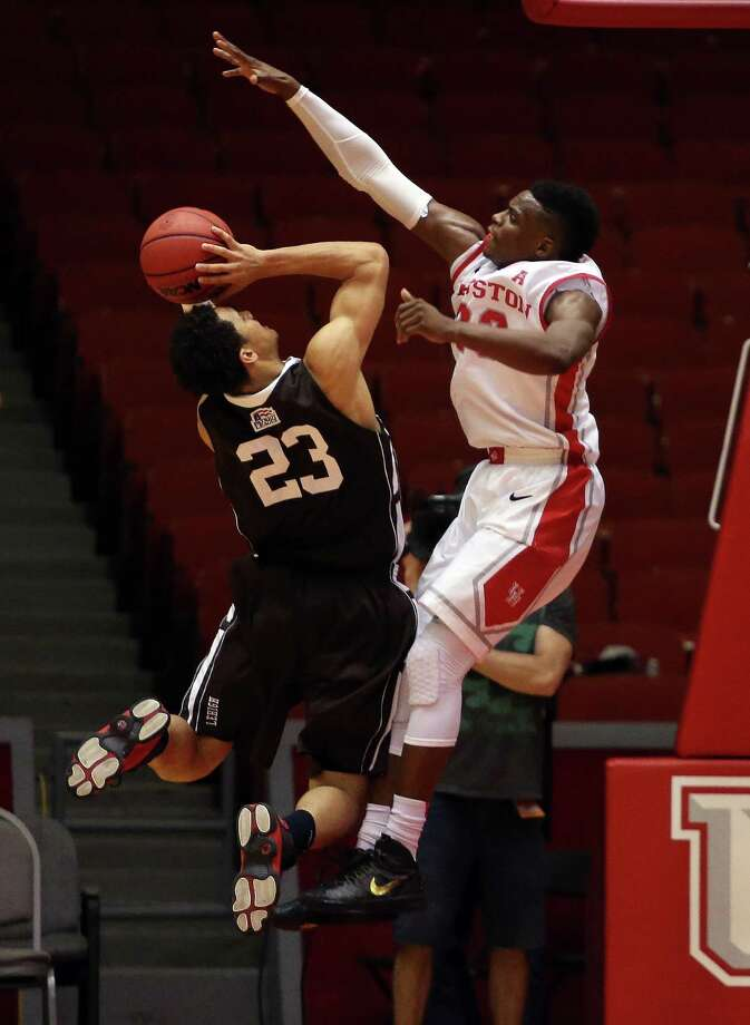 Houston's Danuel House, right, defends against Lehigh's Shane Whitfield during the second half of an NCAA college basketball game, Sunday, November 17, 2013, at Hofheinz Pavilion in Houston. Photo: Eric Christian Smith, For The Chronicle