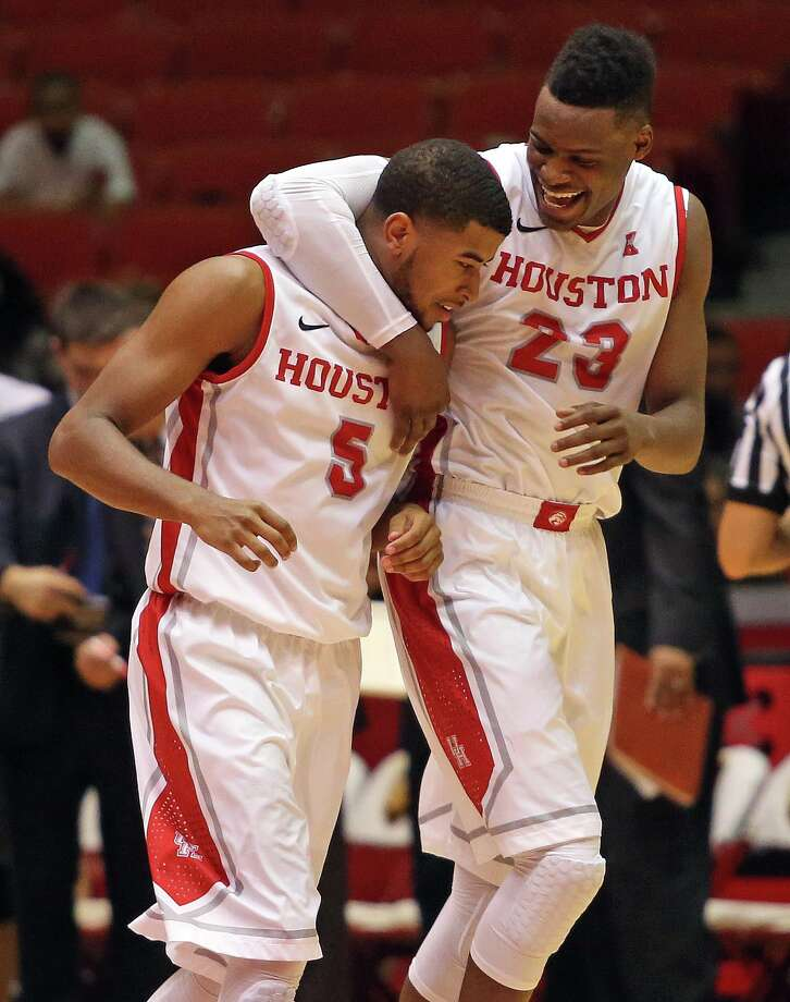 Danuel House, right, and teammate L.J. Rose are questionable to play against the defending NCAA champions on Thursday night. Photo: Eric Christian Smith, For The Chronicle