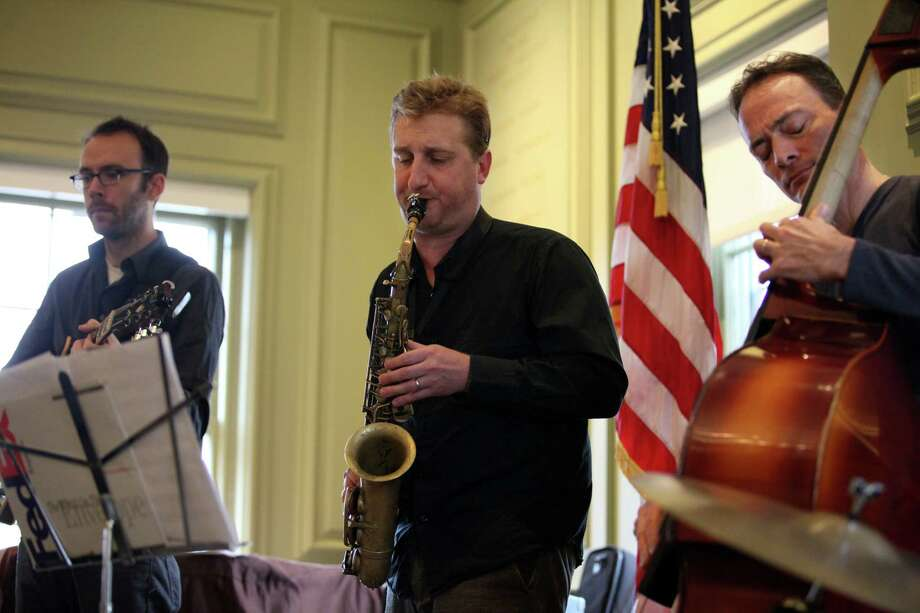 Members of  the Sean Smith quartet, from left, Nate Radley, Loren Stillman and Sean Smith play at the Fairfield Public Library on Sunday, Nov. 17, 2013. Photo: BK Angeletti, B.K. Angeletti / Connecticut Post freelance B.K. Angeletti