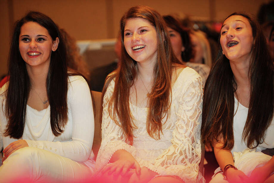 From left; Greenwich High junior varsity cheerleaders Melissa Fraioli, Amanda Nielsen, and Julia Conti, react with smiles from the front row at the 2013 GHS Cheerleading Holiday Fashion Show at the Hyatt Regency Greenwich on Sunday, November 17, 2013. Photo: Brian A. Pounds / Connecticut Post