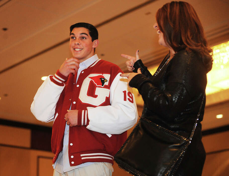 Greenwich High football player Jonathan Fischer, left, and cheerleader Ashley Grudzinski, ham it up on the catwalk at the 2013 GHS Cheerleading Holiday Fashion Show at the Hyatt Regency Greenwich on Sunday, November 17, 2013. Photo: Brian A. Pounds / Connecticut Post