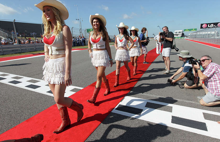 The COTA grid girls prepare for the start of Sunday's race at The Formula One United States Grand Prix at the Circuit of the Americas near Austin, Texas on Sunday, Nov. 17,  2013. Current World Champion Sebastian Vettle finished first followed by Lotus F1's Romain Grojean and in third was Vettel's teammate, Mark Webber. Photo: Kin Man Hui, San Antonio Express-News / ©2013 San Antonio Express-News
