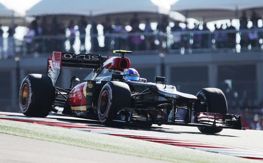 Lotus F1's Romain Grosjean exits Turn 1 during The Formula One United States Grand Prix at the Circuit of the Americas near Austin, Texas on Sunday, Nov. 17,  2013. Grosjean placed second in the race as current World Champion Sebastian Vettle finished first and in third was Vettel's teammate, Mark Webber. Photo: Kin Man Hui, San Antonio Express-News / ©2013 San Antonio Express-News