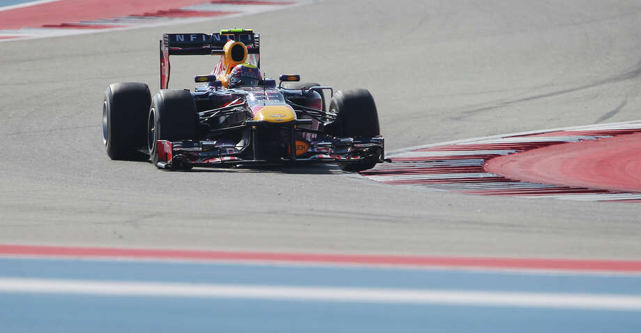 Infiniti Red Bull Racing's Mark Webber negotiates a turn during The Formula One United States Grand Prix at the Circuit of the Americas near Austin, Texas on Sunday, Nov. 17,  2013. Webber finished second in the race as current World Champion and teammate Sebastian Vettle finished first followed by Lotus F1's Romain Grosjean. Photo: Kin Man Hui, San Antonio Express-News / ©2013 San Antonio Express-News