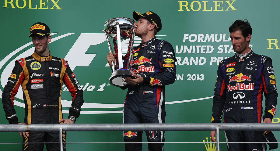 2013 USGP winner and current World Champion Sebastian Vettel kisses the first place trophy at the Formula One United States Grand Prix at the Circuit of the Americas near Austin, Texas on Sunday, Nov. 17,  2013. Vettle finished first followed in second by Lotus F1's Romain Grosjean and in third was Vettel's teammate, Mark Webber. Photo: Kin Man Hui, San Antonio Express-News / ©2013 San Antonio Express-News