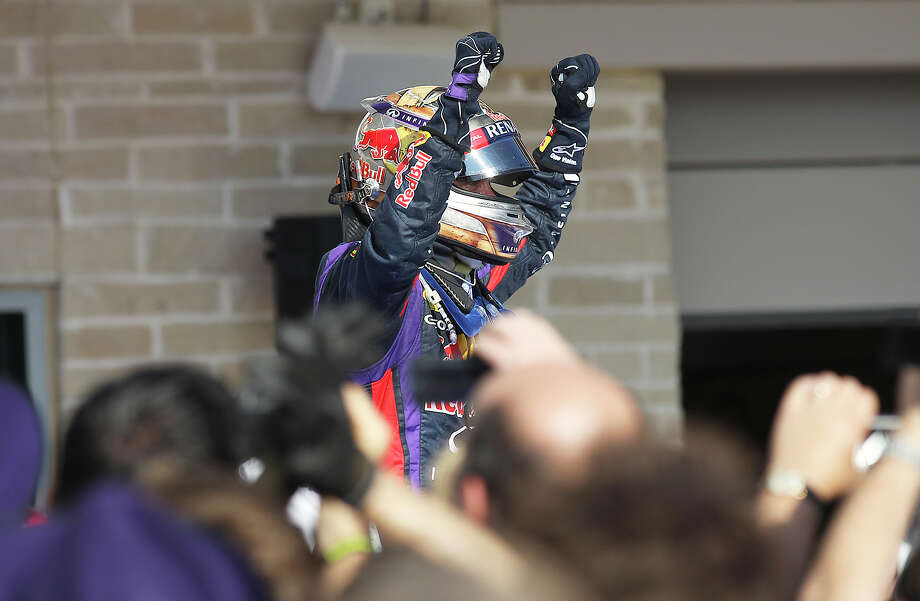 2013 USGP winner and current World Champion Sebastian Vettel gestures after the Formula One United States Grand Prix at the Circuit of the Americas near Austin, Texas on Sunday, Nov. 17,  2013. Vettle finished first followed by Lotus F1's Romain Grosjean and in third was Vettel's teammate, Mark Webber. Photo: Kin Man Hui, San Antonio Express-News / ©2013 San Antonio Express-News