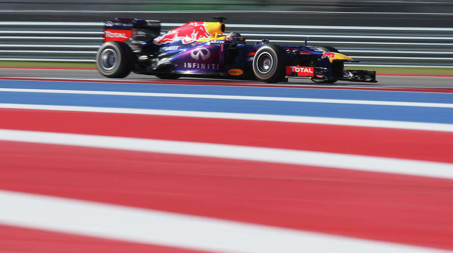 World Champion Sebastian Vettel zips through turns during The Formula One United States Grand Prix at the Circuit of the Americas near Austin, Texas on Sunday, Nov. 17,  2013. Vettle finished first followed by Lotus F1's Romain Grosjean and in third was Vettel's teammate, Mark Webber. Photo: Kin Man Hui, San Antonio Express-News / ©2013 San Antonio Express-News