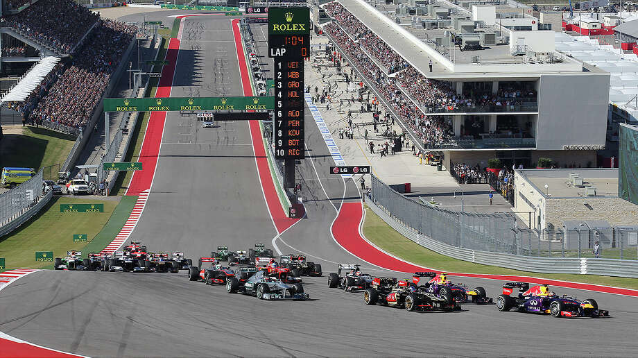 World Champion Sebastian Vettel (far right) leads the pack into Turn 1 during The Formula One United States Grand Prix at the Circuit of the Americas near Austin, Texas on Sunday, Nov. 17,  2013. Vettle finished first followed by Lotus F1's Romain Grojean and in third was Vettel's teammate, Mark Webber. Photo: Kin Man Hui, San Antonio Express-News / ©2013 San Antonio Express-News