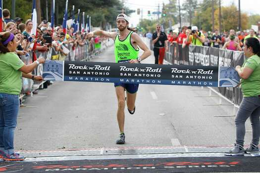 Michael Wardian of Arlington, Va., approaches the finish line of the marathon during the Rock 'n' Roll San Antonio Marathon and 1/2 Marathon on Sunday, Nov. 17, 2013.  Wardian took the men's title  in the marathon with a time of 2:31.19. Photo: Marvin Pfeiffer, San Antonio Express-News / Express-News 2013