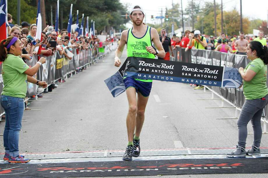 Michael Wardian of Arlington, Va., crosses the finish line of the marathon during the Rock 'n' Roll San Antonio Marathon and 1/2 Marathon on Sunday, Nov. 17, 2013.  Wardian took the men's title  in the marathon with a time of 2:31.19. Photo: Marvin Pfeiffer, San Antonio Express-News / Express-News 2013