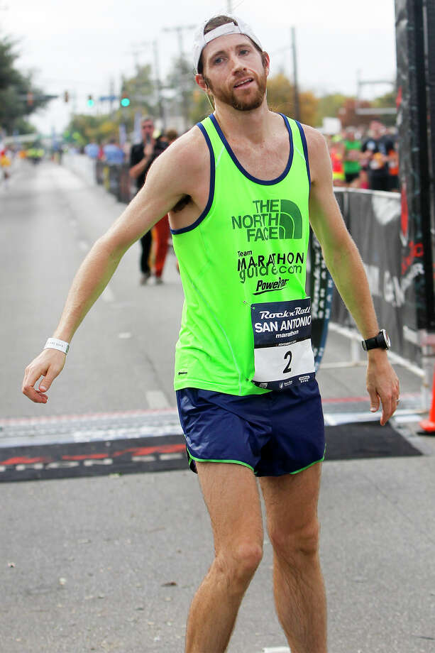 Michael Wardian of Arlington, Va., after crossing the finish line of the marathon during the Rock 'n' Roll San Antonio Marathon and 1/2 Marathon on Sunday, Nov. 17, 2013.  Wardian took the men's title  in the marathon with a time of 2:31.19. Photo: Marvin Pfeiffer, San Antonio Express-News / Express-News 2013