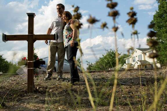 Blake Pate's nephew Eric Jones and sister Kathy Self visit a monument the family erected across from the shooting scene.