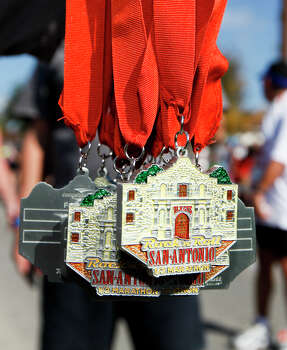 Medals for the half marathon given to participants following the Rock 'n' Roll San Antonio Marathon and 1/2 Marathon on Sunday, Nov. 17, 2013. Photo: Marvin Pfeiffer, San Antonio Express-News / Express-News 2013