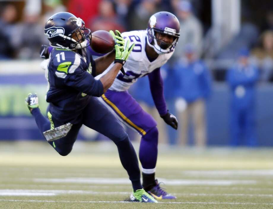 Seattle Seahawks' Percy Harvin (11) catches the ball in front of Minnesota Vikings' Chris Cook in the first half of an NFL football game Sunday, Nov. 17, 2013, in Seattle. (AP Photo/John Froschauer) Photo: AP
