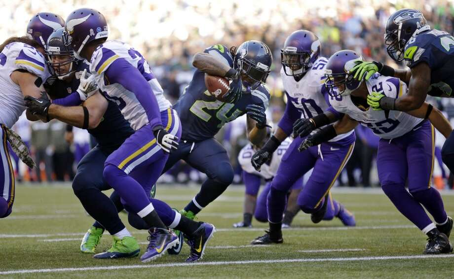 Seattle Seahawks' Marshawn Lynch (24) finds a hole as he heads to score against the Minnesota Vikings in the first half of an NFL football game Sunday, Nov. 17, 2013, in Seattle. (AP Photo/Ted S. Warren) Photo: ASSOCIATED PRESS