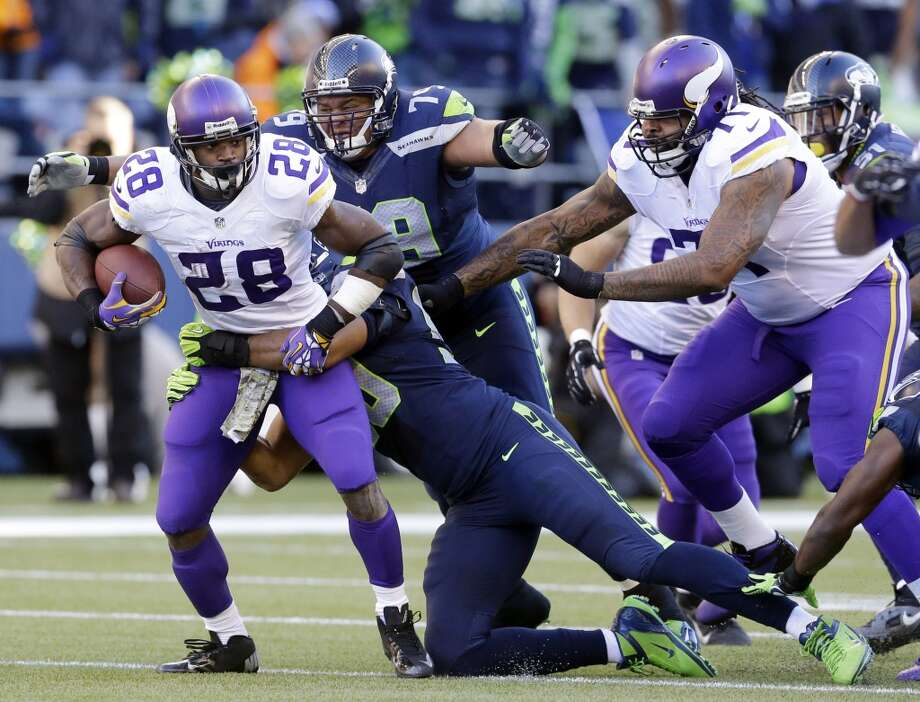 Seattle Seahawks' Red Bryant (79) pursues Minnesota Vikings' Adrian Peterson who is tackled on a carry in the first half of an NFL football game Sunday, Nov. 17, 2013, in Seattle. (AP Photo/Ted S. Warren) Photo: ASSOCIATED PRESS