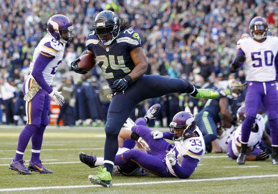 Seattle Seahawks' Marshawn Lynch (24) scores against Minnesota Vikings in the first half of an NFL football game Sunday, Nov. 17, 2013, in Seattle. (AP Photo/John Froschauer) Photo: ASSOCIATED PRESS