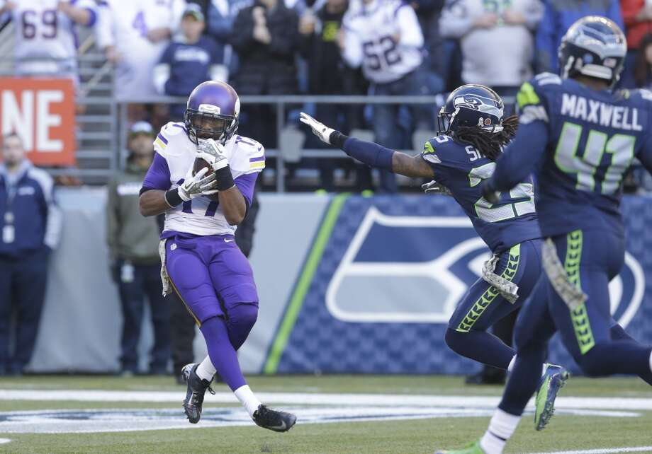 Minnesota Vikings' Jarius Wright (17) catches a touchdown pass in the end zone against the Seattle Seahawks in the first half of an NFL football game, Sunday, Nov. 17, 2013, in Seattle. (AP Photo/Ted S. Warren) Photo: ASSOCIATED PRESS