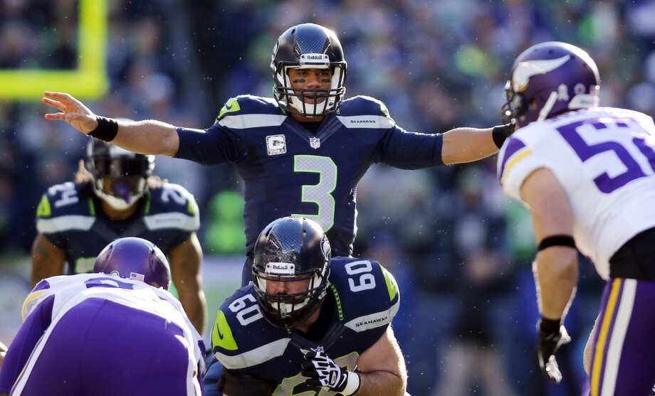 Seattle Seahawks quarterback Russell Wilson (3) lines up behind Max Unger (60) to take a snap against the Minnesota Vikings in the first half of an NFL football game Sunday, Nov. 17, 2013, in Seattle. (AP Photo/John Froschauer) Photo: ASSOCIATED PRESS