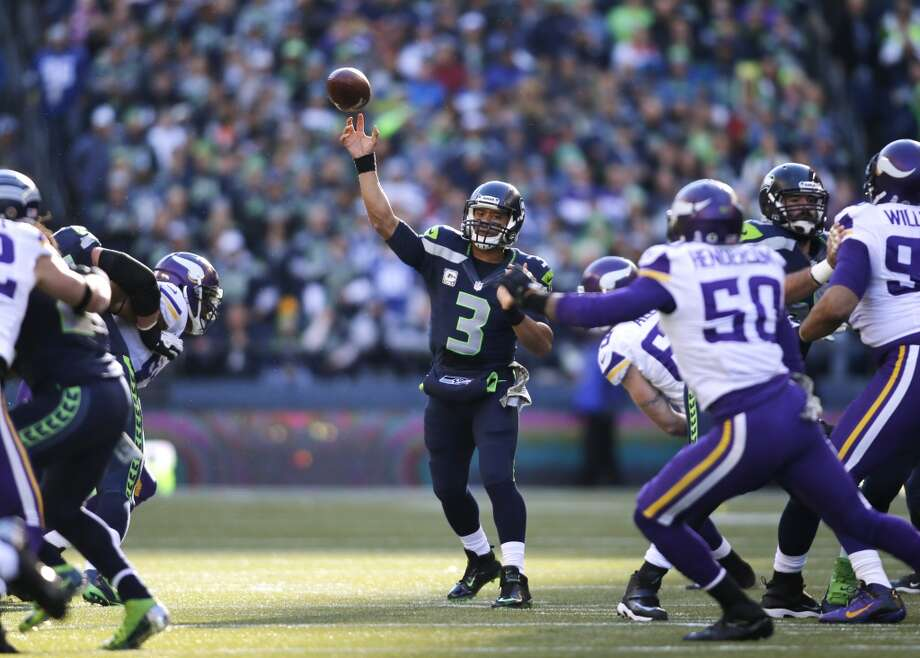 Seattle Seahawks quarterback Russell Wilson (3) throws against the Minnesota Vikings in the first half of an NFL football game, Sunday, Nov. 17, 2013, in Seattle. (AP Photo/John Froschauer) Photo: ASSOCIATED PRESS