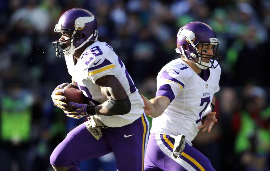 Minnesota Vikings quarterback Christian Ponder (7) hands off to Adrian Peterson in the first half of an NFL football game Sunday, Nov. 17, 2013, in Seattle. (AP Photo/John Froschauer) Photo: ASSOCIATED PRESS