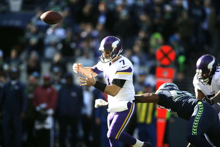 Minnesota Vikings quarterback Christian Ponder (7) loses the ball as he is hit by Seattle Seahawks' Cliff Avril in the first half of an NFL football game, Sunday, Nov. 17, 2013, in Seattle. (AP Photo/John Froschauer) Photo: AP