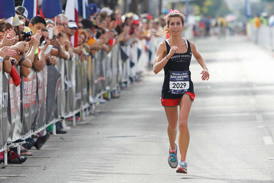 Jenna Kincaid of Austin approaches the finish line of the marathon during the Rock 'n' Roll San Antonio Marathon and 1/2 Marathon on Sunday, Nov. 17, 2013.  Kincaid took the women's title  in the marathon with a time of 3:07.41. Photo: Marvin Pfeiffer, San Antonio Express-News / Express-News 2013