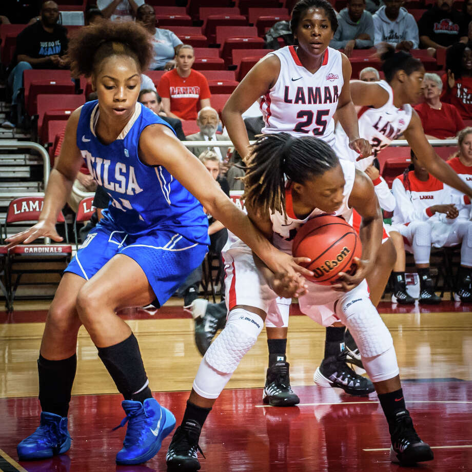 Lamar Lady Cardinals, Gia Ayers, rebounds against Tulsa Golden Hurricane in a match up Sunday night at the Montagne Center. Photo: Michael Reed / Michael Reed