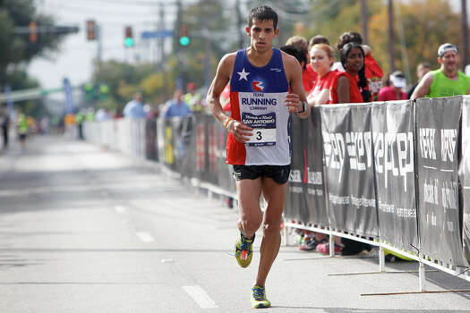 Moses Luevano of Boerne approaches the finish line of the marathon during the Rock 'n' Roll San Antonio Marathon and 1/2 Marathon on Sunday, Nov. 17, 2013.  Luevano took second in the men's marathon division a time of 2:34.44. Photo: Marvin Pfeiffer, San Antonio Express-News / Express-News 2013