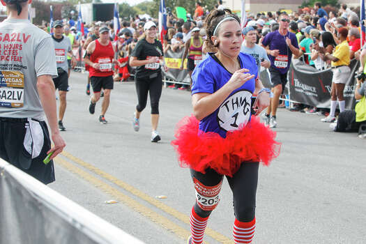 Andrea Torres of College Station approaches the finish line of the half marathon dresses as Thing 1 during the Rock 'n' Roll San Antonio Marathon and 1/2 Marathon on Sunday, Nov. 17, 2013. Photo: Marvin Pfeiffer, San Antonio Express-News / Express-News 2013