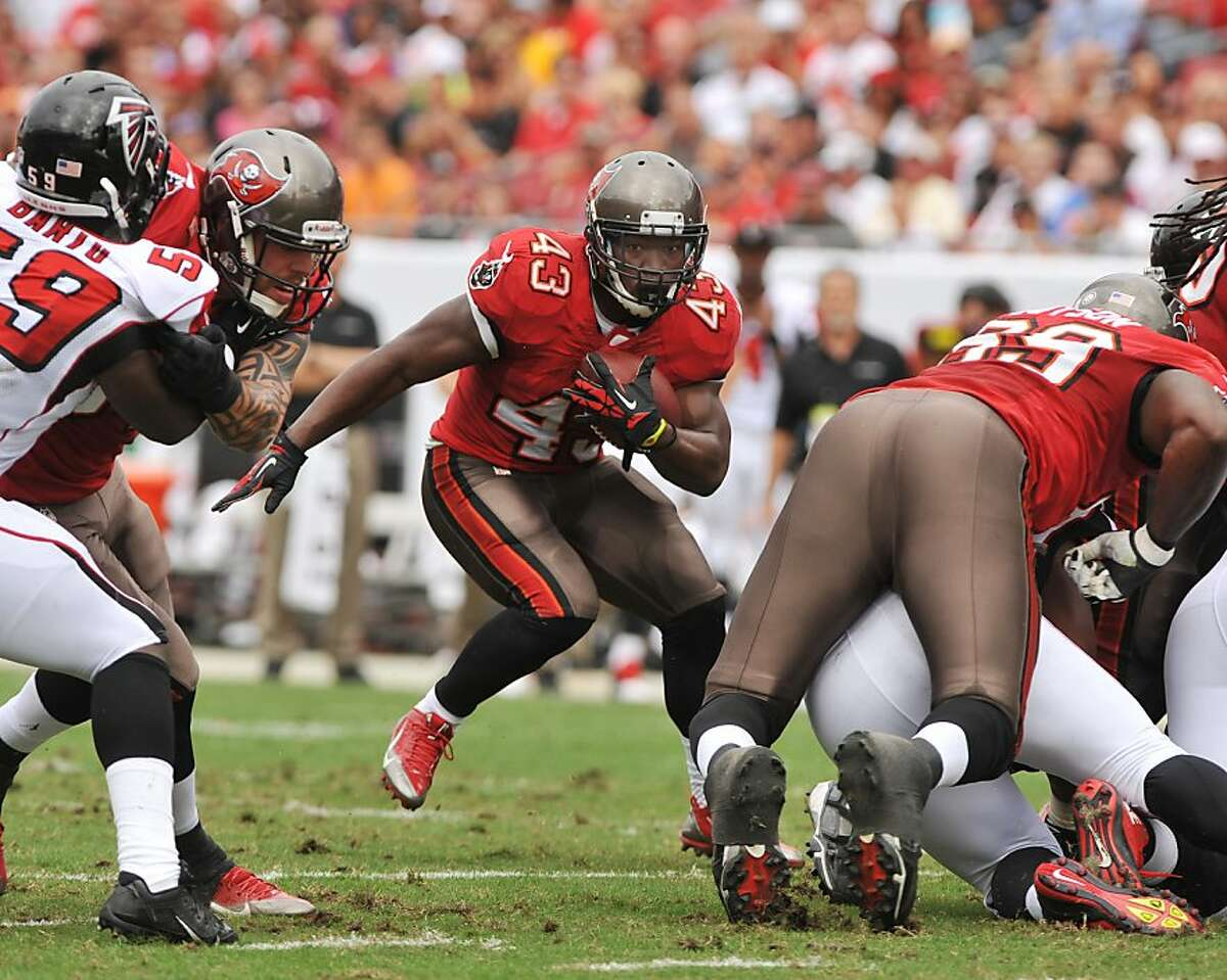 TAMPA, FL - NOVEMBER 17: Running back Bobby Rainey #43 of the Tampa Bay Buccaneers rushes upfield against the Atlanta Falcons November 17, 2013 at Raymond James Stadium in Tampa, Florida. The Bucs won 41 - 28 and Rainey scored three times. (Photo by Al Messerschmidt/Getty Images)