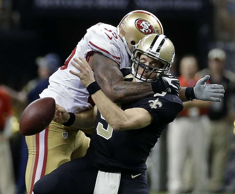 New Orleans Saints quarterback Drew Brees (9) is sacked by San Francisco 49ers outside linebacker Ahmad Brooks (55) in the second half of an NFL football game in New Orleans, Sunday, Nov. 17, 2013. (AP Photo/Dave Martin) Photo: Dave Martin, Associated Press