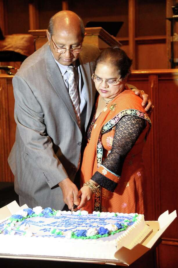 Ester and her husband Alfred Gill cut a cake to help celebrate the 10 anniversary of the Aske Jesus Gospel Music Ministry USA on Oct. 26 at the City Harvest Family Church on Central Avenue in Albany. (Submitted photo)