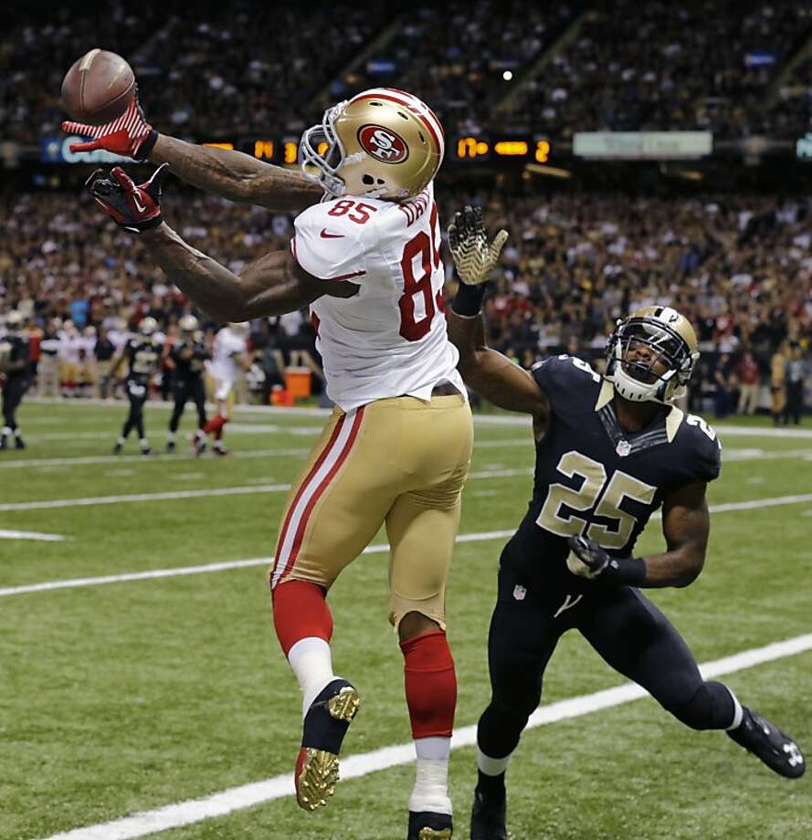 San Francisco 49ers tight end Vernon Davis (85) can't hang on to a pass as New Orleans Saints free safety Rafael Bush (25) covers in the second half of an NFL football game in New Orleans, Sunday, Nov. 17, 2013. (AP Photo/Bill Haber) Photo: Bill Haber, Associated Press