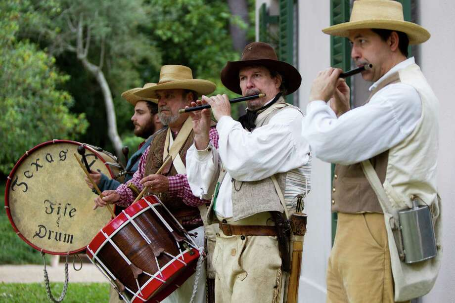 Texas Army Fife and Drum Corp. performers Cameron Lyman, Colonel Jerry Tubbs, Colonel Dennis Heckathorne  and Rick Eddy play for the visitors spending the afternoon at the Museum of Fine Arts Family Day at the Bayou Bend Collection and Gardens, Sunday, Nov. 17, 2013. Photo: Marie D. De Jesús, Houston Chronicle / © 2013 Houston Chronicle