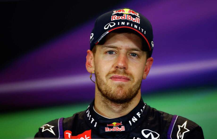 AUSTIN, TX - NOVEMBER 17:  Sebastian Vettel of Germany and Infiniti Red Bull Racing talks to the media after winning the United States Formula One Grand Prix at Circuit of The Americas on November 17, 2013 in Austin, United States. Vettel has won a record-setting eight consecutive races and clinched the 2013 F1 championship title.  (Photo by Tom Pennington/Getty Images) Photo: Tom Pennington, Staff / 2013 Getty Images