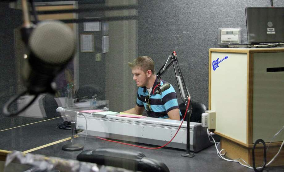 Alvin Community College student Austin Higgins mans the board at the college's rock radio station 89.7 FM KACC. Photo: Tony Freemantle, Houston Chronicle