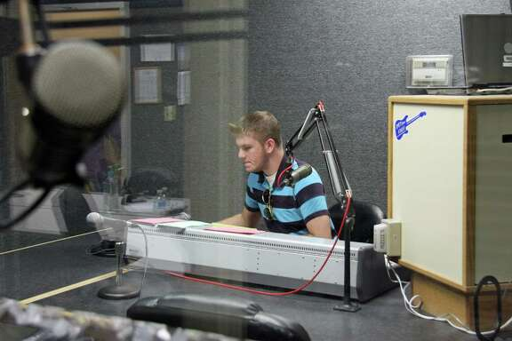 Alvin Community College student Austin Higgins mans the board at the college's rock radio station 89.7 FM KACC.